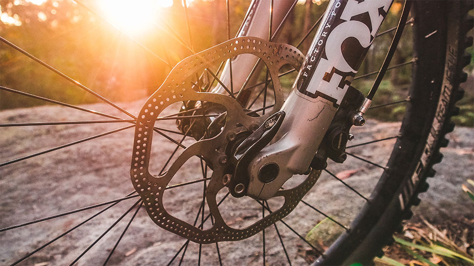 How do you clean disc brakes?